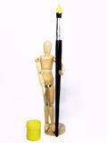 Burattino di legno con una spazzola Immagini Stock Libere da Diritti