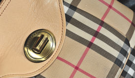 Burberry design 3. The photograph shows the design of the famous burberry brand, with the inscription engraved in a closed bag, the lighting is accurate to Stock Image