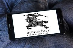 Burberry fashion brand logo. Logo of Burberry on samsung mobile. Burberry Group plc is a British luxury fashion house. Its main fashion house focuses on and royalty free stock image