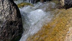 Burbling water flowing through rocks. stock video