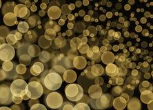 Burbujas amarillas abstractas de Bokeh en fondo negro Foto de archivo libre de regalías
