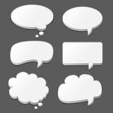 Burbujas blancas del discurso fijadas en negro Foto de archivo libre de regalías