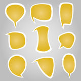 Burbujas caligráficas del discurso del color amarillo Fotos de archivo libres de regalías