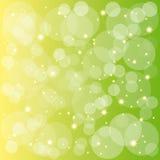 Burbujas chispeantes de las estrellas en fondo amarillo verde Fotografía de archivo libre de regalías