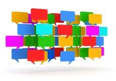 Burbujas coloridas del discurso en el fondo blanco Imagen de archivo libre de regalías