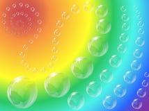 Burbujas con el fondo del arco iris imagen de archivo