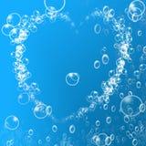 Burbujas de aire en forma de corazón Fotos de archivo libres de regalías