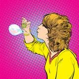 Burbujas de jabón de la chica joven que soplan Imagen de archivo libre de regalías