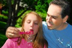 Burbujas de la familia Fotos de archivo libres de regalías