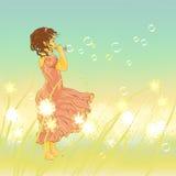Burbujas de la niña y de jabón Imagen de archivo libre de regalías