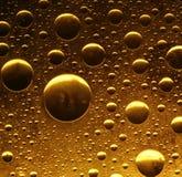 Burbujas de oro Fotografía de archivo