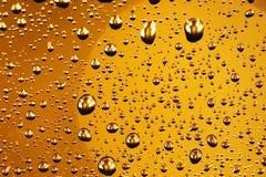 Burbujas de oro Imágenes de archivo libres de regalías