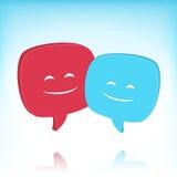 Burbujas del discurso con las caras sonrientes Imagen de archivo