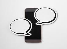 2 burbujas del discurso en smartphone Imagen de archivo libre de regalías