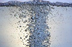 Burbujas en un agua Imagenes de archivo