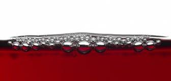 Burbujas en vino rojo Imagen de archivo