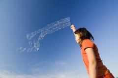 Burbujas que soplan Imágenes de archivo libres de regalías