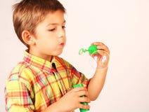 Burbujas que soplan Imagen de archivo libre de regalías