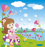Burbujas que soplan de la muchacha Fotografía de archivo