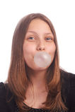 Burbujas que soplan de la muchacha adolescente en el fondo blanco Fotos de archivo libres de regalías