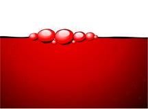Burbujas rojas en el vino rojo