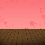 Burbujas rosadas abstractas del corazón con el fondo de madera foto de archivo