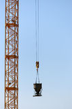 Burden lifting crane Stock Images