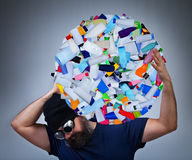 Burden of pollution. Man carrying a globe made of plastic bottles, environmental destruction concept Stock Images