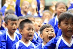 Elementary school students excited. Without burden, they shout, move and laugh, they are elementary school students in a village in Indonesia Stock Images