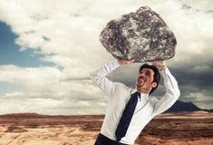 Burdened businessman Royalty Free Stock Images
