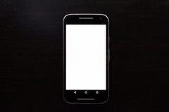 Bureau blanc vide en bois de noir d'Android de téléphone portable de cadre d'écran photographie stock libre de droits