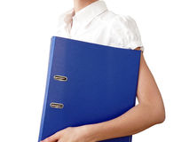 bureau bleu de main de fille de dépliant photographie stock