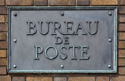 Bureau de Poste. French post office sign made of brass and bolted on a brick wall Stock Image