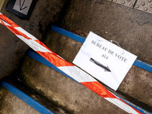 Bureau de vote sign on floor damaged secure stripe. Bureau de vote sign on floor near pooling place during the second round of the French presidential election Royalty Free Stock Image