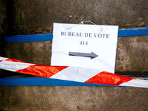 Bureau de vote sign on floor damaged secure stripe. Bureau de vote sign on floor near pooling place during the second round of the French presidential election Stock Images