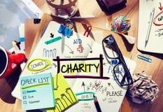 Bureau multicolore de concept de charité avec des notes Image stock