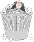 Bureaucrat in wastepaper basket Stock Photography