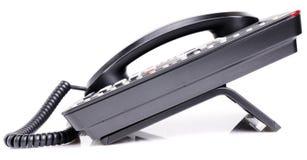 Bureautelefoon over witte achtergrond Stock Foto's