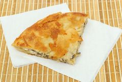 Burek or pie with cheese and mushrooms on a paper seviettes Royalty Free Stock Images