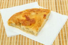 Burek or pie with cheese on a paper serviettes Royalty Free Stock Photo