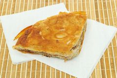 Burek or pie with meat and on a paper seviettes Stock Photography