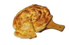 Burek sa sirom. Serbian stile pastries -  Domaci burek sa sirom, savijaca na dasci Royalty Free Stock Image