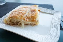 Burek - traditional balkan food. Burek traditional balkan food with cheese on a plate in small bakery stock images