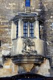 Burford coat on arms on building. Royalty Free Stock Image