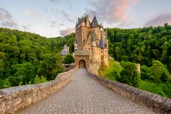 Burg Eltz castle in Rhineland-Palatinate at sunset. Burg Eltz castle in Rhineland-Palatinate state at sunset, Germany. Construction startedprior to 1157 stock image