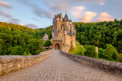 Burg Eltz castle in Rhineland-Palatinate at sunset. Burg Eltz castle in Rhineland-Palatinate state at sunset, Germany. Construction startedprior to 1157 stock photos