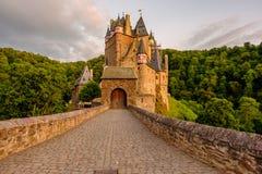 Burg Eltz castle in Rhineland-Palatinate at sunset Stock Photos