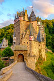 Burg Eltz castle in Rhineland-Palatinate at sunset. Burg Eltz castle in Rhineland-Palatinate state at sunset, Germany. Construction startedprior to 1157 Stock Photography