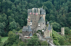 Burg Eltz historic castle situated on the Elz River in Germany - horizontal format. Burg Eltz storybook 12th century castle situated on the Elz River in the royalty free stock images