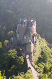 Burg Eltz is a medieval castle nestled in the hills above the Mo Stock Photography